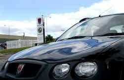 De Britse autoconstructeur MG Rover komt in handen van het Chinese Nanjing Automobile.