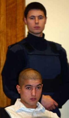 Loopt Mohamed Hammani (onder) over twee jaar weer vrij rond?