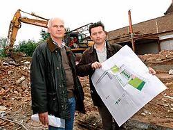Schepenen Louis Haerinck en Jo Tijtgat willen een groen parkeereiland op 100 meter van het centrum. David Stockman