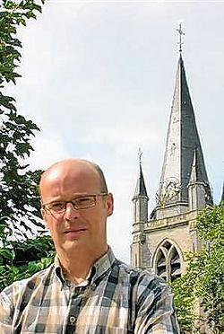 Stadsbeiaardier Dominique Wybraeke bij de Sint-Hermestoren. <br> Guy Van Den Bossche<br>