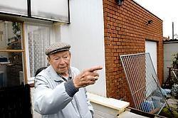 Gustave Noens ziet een verandamuur ingenomen door de bouwovertreding van zijn buurman. David Stockman<br>