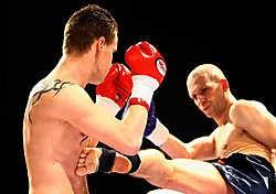 Marijn Geuens (links) haalde het van Jochem Waegemans in de strijd om de Belgische titel in het Thaiboksen. Yorick Jansens