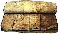 De aan stukken gesneden perkamenten boekrol die ter versteviging in een omslag van de Mechelse stadsrekeningen werd geplakt