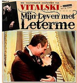 De affiche van de voorstelling, met een kussende Leterme en Milquet. rr<br>