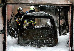 Vermoedelijk was een kortsluiting oorzaak van de brand in de garage. Louis Verbraeken