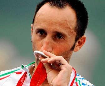 Davide Rebellin pakte in de olympische wegrit zilver op cera.epa