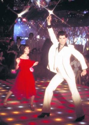 John Travolta en Karen Lynn Gorney in 'Saturday Night Fever'. photo news