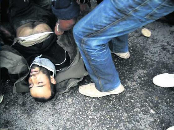 Gewonde manifestant in Regueb, Tunisië.afp