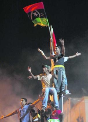 Vreugde in Benghazi bij het horen van de opstand in Tripoli. Alexandre Meneghini/ap