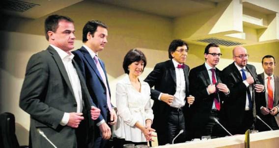Formateur Di Rupo en de zes onderhandelende partijvoorzitters zijn tevreden met de begroting.Bart Dewaele