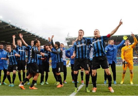 De spelers van Club vieren de zege tegen Standard. 'We hebben nog een lange weg te gaan', waarschuwt hun coach Michel Preud'homme.