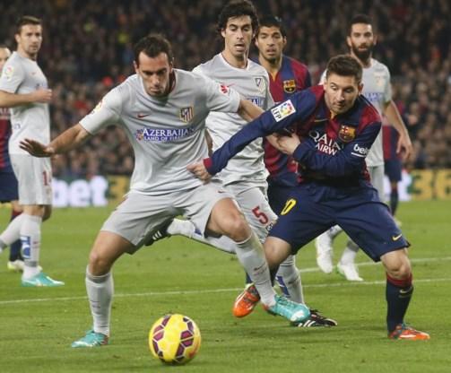PRIMERA DIVISION. Barcelona bibbert tegen Atletico, Real wint makkelijk met tien
