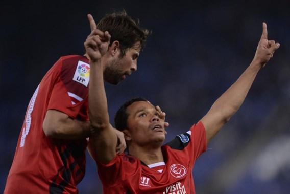 PRIMERA DIVISION. Sevilla verliest na penaltymisser Bacca, Barcelona dolt