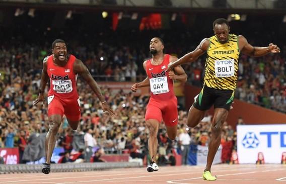 Usain Bolt (r.) blijft toch de snelste man op aarde. Favoriet Justin Gatlin (l.) komt tekort.