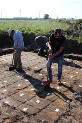 De archeologen aan het werk.