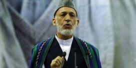Karzai roept Afghanen op terug te keren