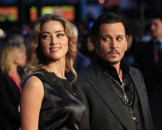Johnny Depp en Amber Heard zijn officieel gescheiden