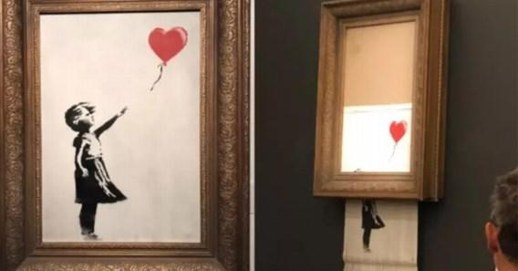 Kunstwerk Banksy vernietigt zichzelf na bod van miljoen euro