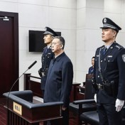 Chinese rechtbank veroordeelt ex-topman Interpol tot 13,5 jaar cel voor corruptie
