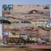 OMA combineert winkelen met cultuur in gigantische rots