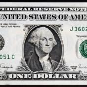 Slavenhouders overleven op dollarbiljetten