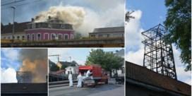 Hulpdiensten ruimen asbest na brand schutterstoren