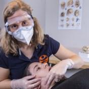 Kinesisten zien stijgend aantal kaakklachten door mondmaskers