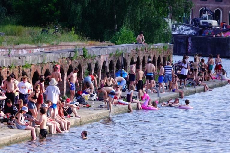 Massa volk op illegale zwemspot in Gent ondanks zwemgevaar